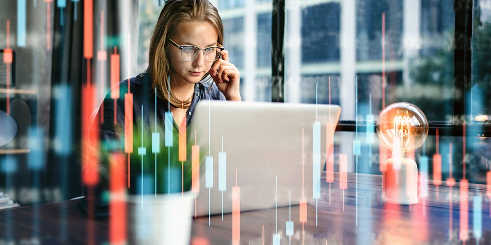 Young,Woman,Working,At,Modern,Office.technical,Price,Graph,And,Indicator,